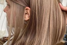 light chestnut hair with ash blonde airtouch highlights is a veyr stylish and chic idea to go for