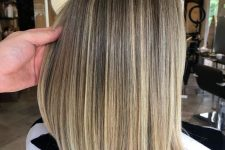 light chestnut hair with blonde airtouch highlights is a bold idea with some contrasting touches