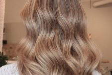 light chestnut hair with slight lighter airtouch highlights is a stylish and glam idea to rock