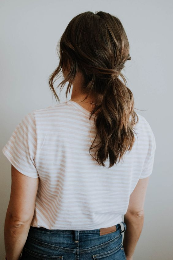 a low twisted ponytail with waves and some locks down is ideal to wear today and it's comfy