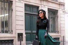 Parisian-style Christmas look with a black top, a green circle skirt, black tights, green shoes, a beret and a box bag