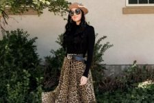 With beige beret, black shirt and ankle boots