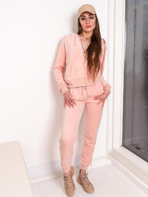 With beige cap, beige sneakers and pale pink pants