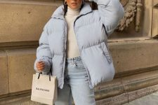 With beige turtleneck, light blue jeans and sunglasses