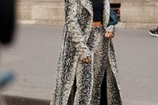 With black crop top, snake printed trousers and black heeled boots