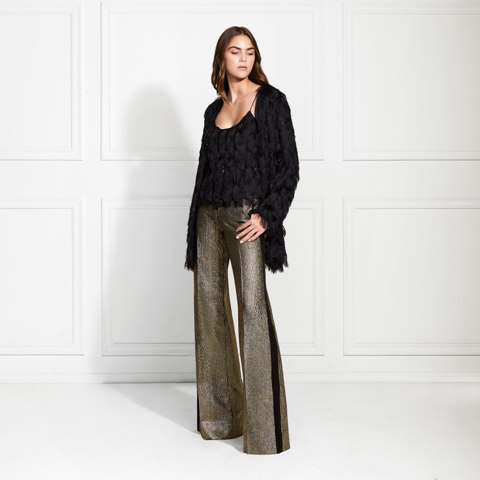 With black fringe top and metallic flare trousers