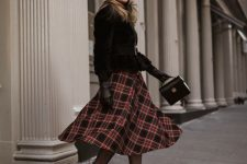 With black fur belted jacket, plaid midi skirt, black mini bag and beret