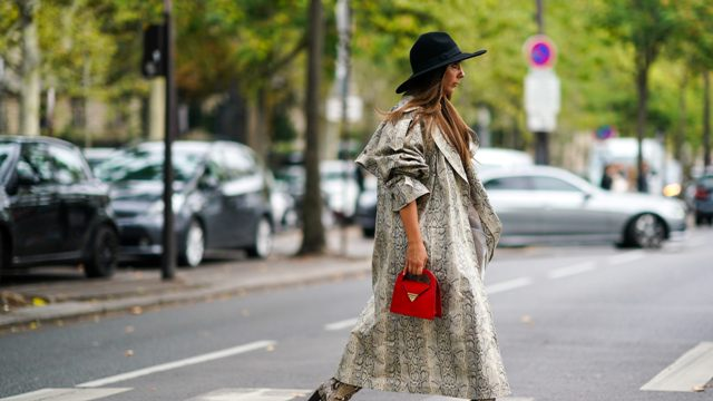 With black hat, red mini bag and printed boots