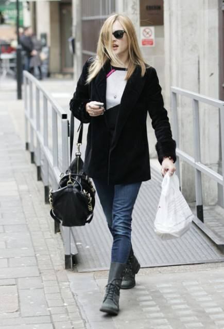 With black jacket, tote bag, jeans and sweater