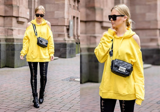 With black leather bag, lace up pants and black ankle boots