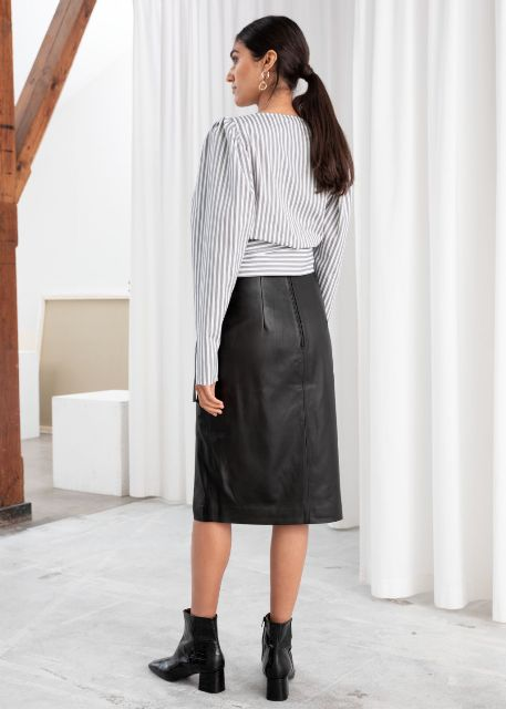 With black leather midi skirt and black ankle boots