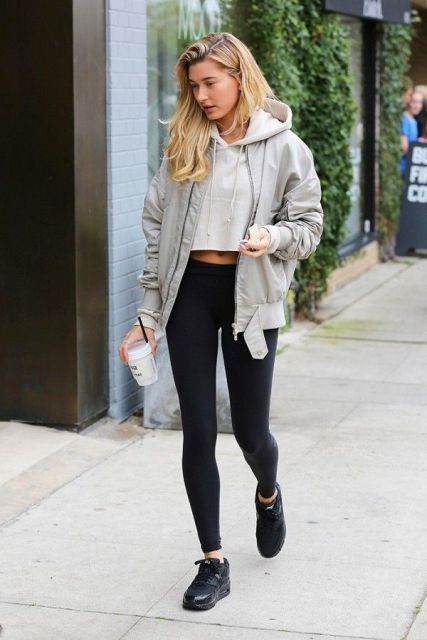 With black leggings, black sneakers and gray jacket