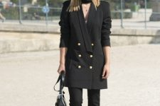 With black long blazer, black bag and white sneakers