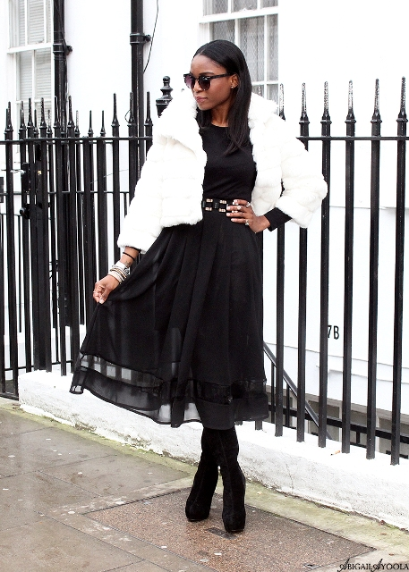 With black midi dress, belt and high boots