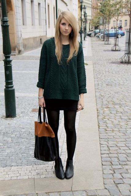 With black mini skirt, black and brown tote bag and black ankle boots