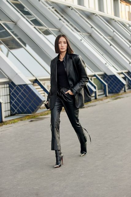 With black shirt, black leather blazer and high heeled boots
