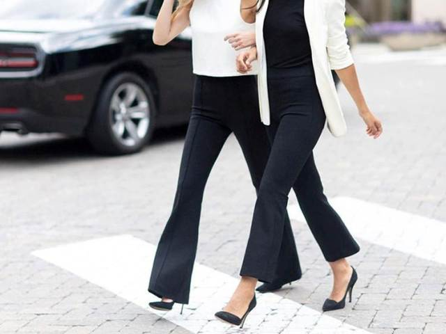 With black shirt, white long blazer and black pumps