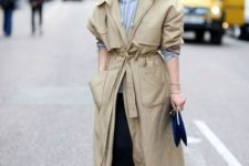 With black skinny pants, beige maxi trench coat, navy blue clutch and printed shoes