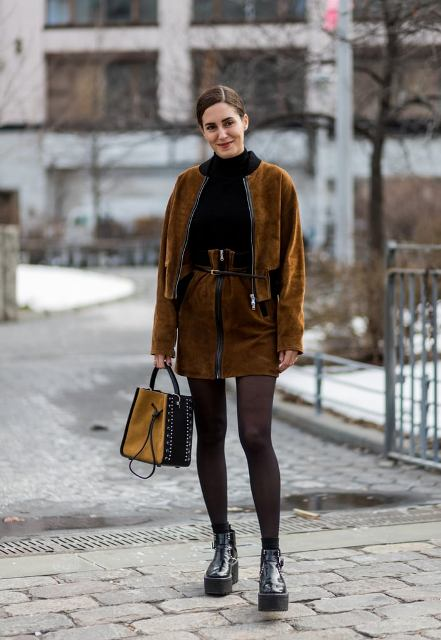 With black sweater, brown suede belted skirt, bag and platform boots