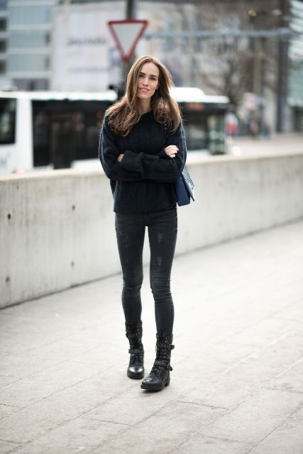 With black sweater, dark gray skinny jeans and navy blue bag