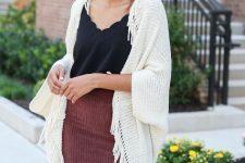 With black top and corduroy mini skirt