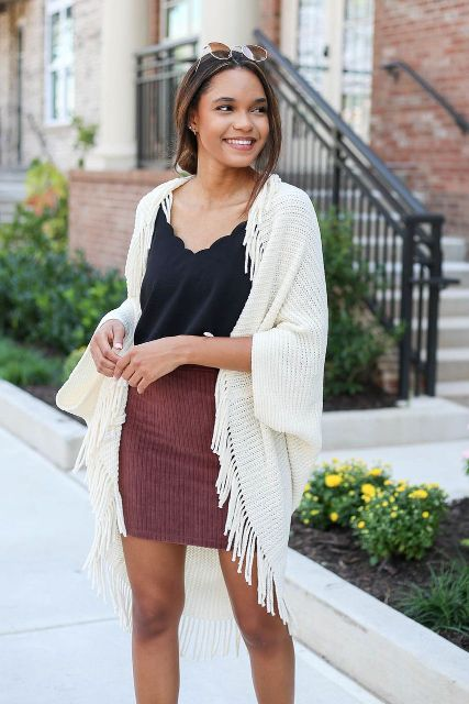 With black top and corduroy mini skirt