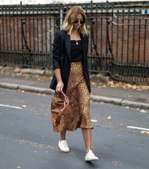 With black top, black long blazer, brown leather bag and white sneakers