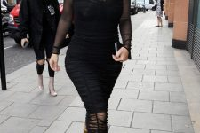 With black transparent midi dress and sunglasses