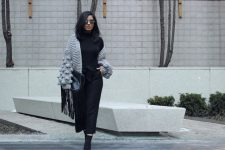 With black turtleneck, black culottes, mid calf boots and fringe clutch