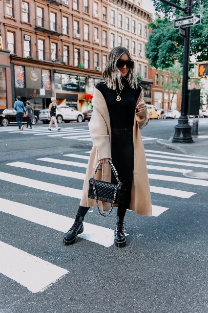 With black turtleneck, jeans, beige midi coat and chain strap bag