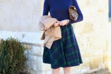 With blue shirt, leopard printed clutch, pastel colored shoes and beige jacket