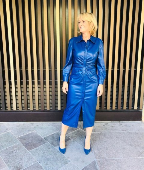 With blue suede pumps