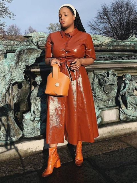 With brown leather bag and brown patent leather ankle boots