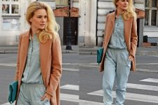 With brown long blazer, clutch and beige pumps