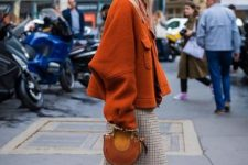 With brown oversized jacket, brown suede bag and light gray high boots