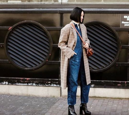 With checked coat, crossbody bag and black leather boots