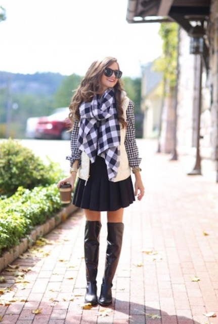 With checked shirt, black pleated skirt, checked scarf and black leather over the knee boots