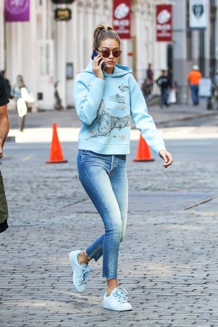 With cropped jeans and light blue shoes