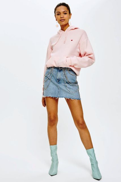 With denim mini skirt and light blue mid calf boots