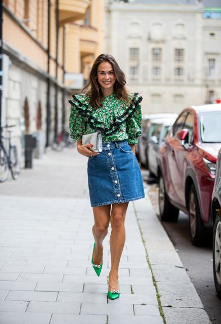 With denim mini skirt, clutch and green embellished pumps