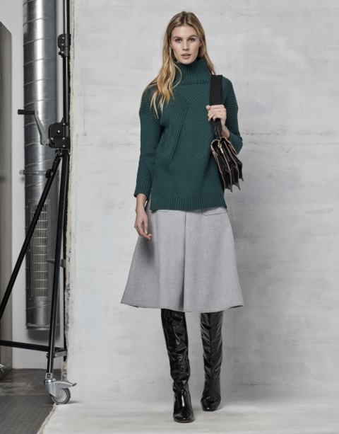 With gray midi skirt, black bag and black patent leather over the knee boots