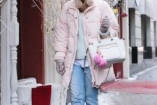 With gray shirt, pale pink hat, white bag, cuffed jeans and faux fur boots