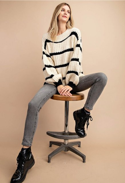 With gray skinny jeans and black lace up flat boots