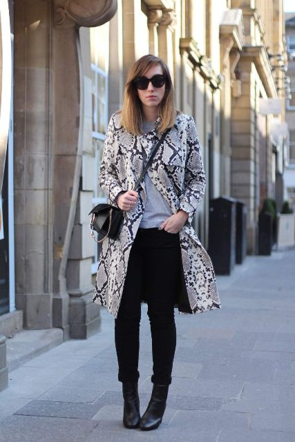 With gray t shirt, black cuffed pants, crossbody bag and black ankle boots