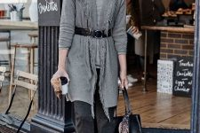 With gray turtleneck, black belt, black tote bag, dark gray trousers and leopard printed shoes
