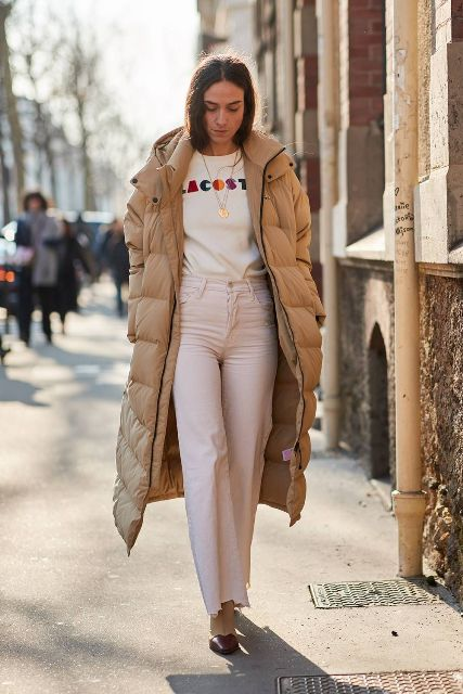 With labeled shirt, white pants and beige and brown boots