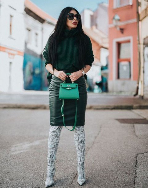 With leather knee-length skirt, green bag and printed over the knee boots