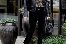 With leopard printed shirt, black leather jacket, black bag and ankle boots