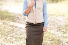 With light blue button down shirt, midi skirt and beige shoes