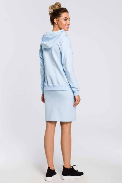 With light blue knee-length skirt and black and white sneakers